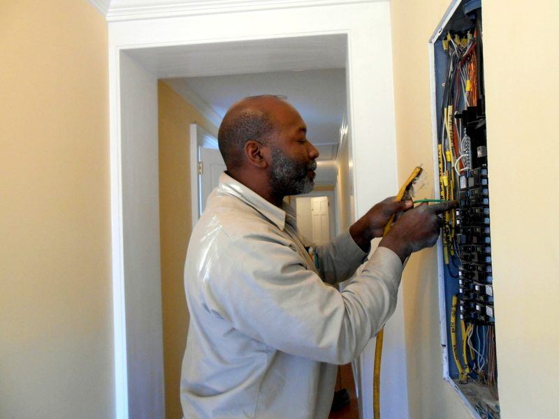 Transworld Inc Electrical Contractors Electrician working on Electrical Panel